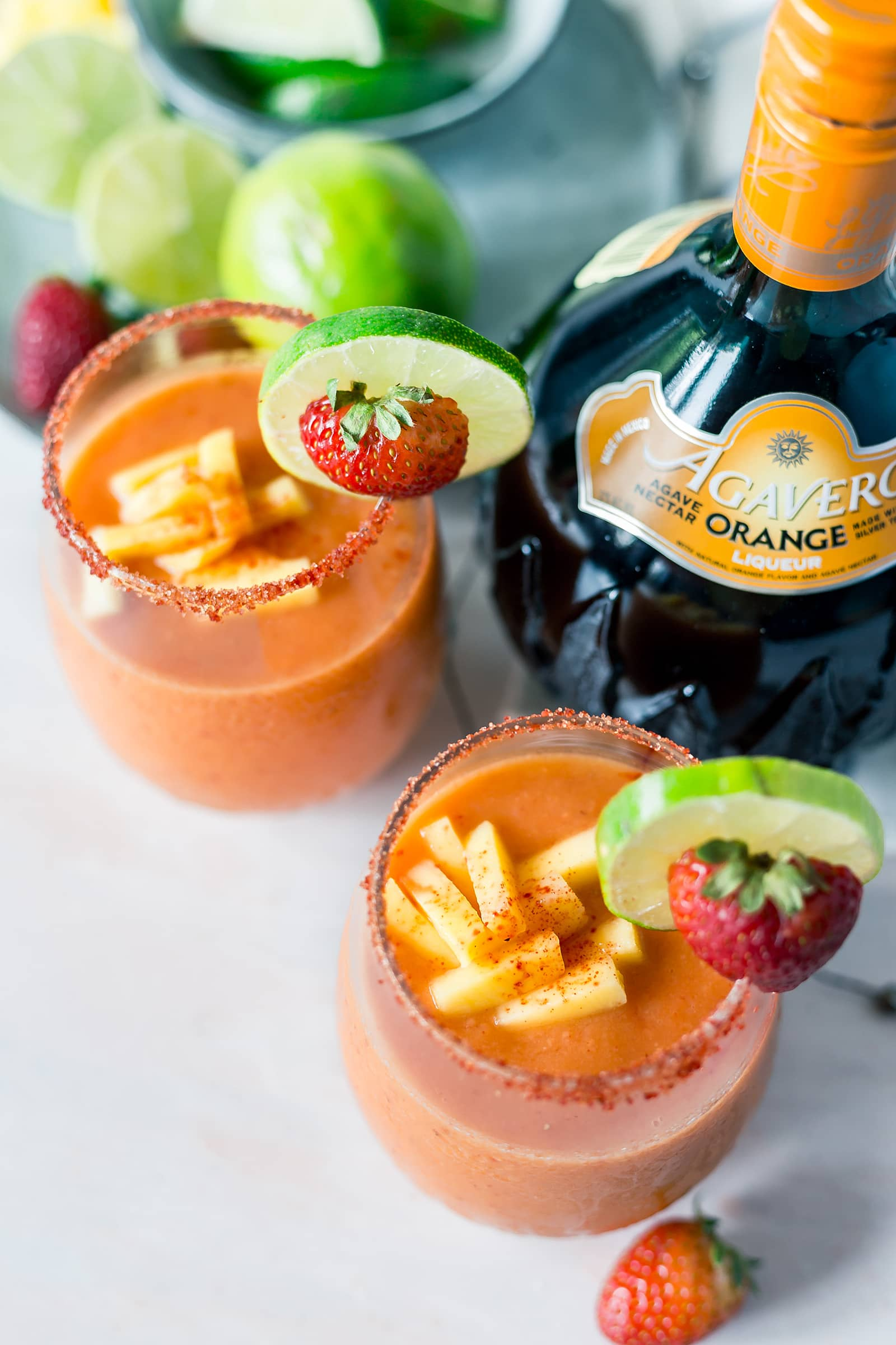 These Strawberry Mango Frozen Margaritas are to. die. for. in the summer heat! They are fruity, refreshing and all around delicious!