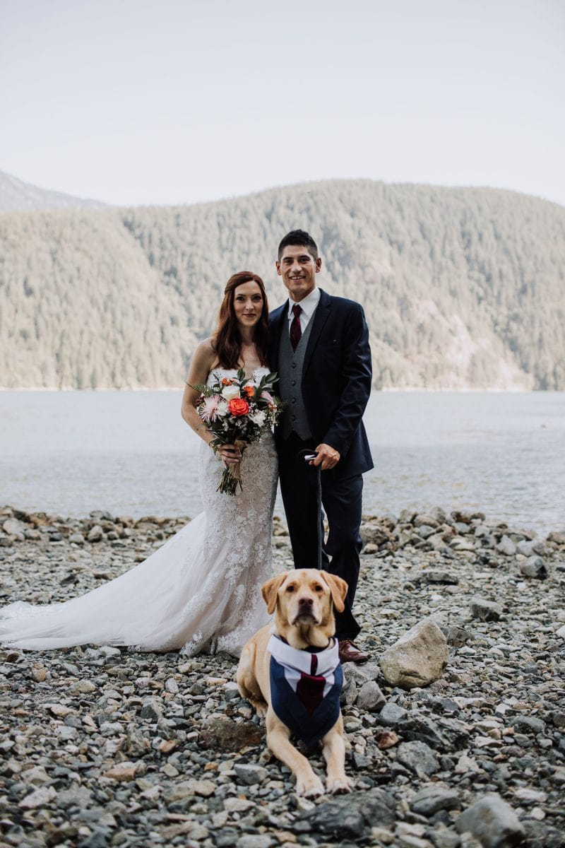 Bride, groom and dog in suit